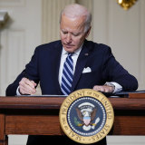 President Joe Biden signs an executive order on climate change earlier this year.