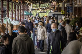 Shoppers with masks at South Melbourne Market yesterday as Melbourne's COVID-19 restrictions continued.