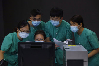 Medical workers make preparations at a temporary field hospital in Hong Kong at the weekend.
