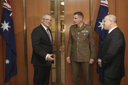 Prime Minister Scott Morrison with chief of the Defence Force General Angus Campbell and secretary of the Department of Defence Greg Moriarty.