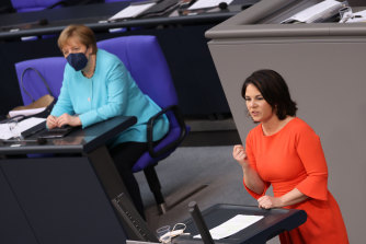 Greens Party chancellor candidate Annalena Baerbock, right, speaks after German Chancellor Angela Merkel,left, gave her last government declaration at the Bundestag on June 24.