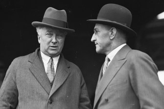 """""""We must avoid becoming insular"""": Prime Minister Joseph Lyons (left) pictured on his return from the UK on August 12, 1935."""