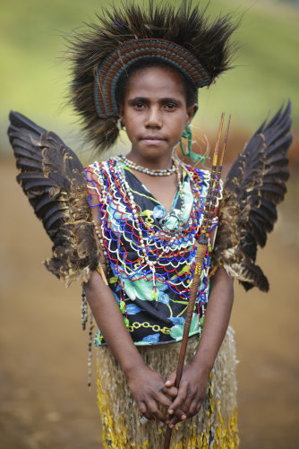 An Eastern Highlands girl in traditional attire in Kainantu.
