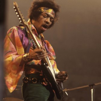 Jimi Hendrix performs live on stage playing a black Fender Stratocaster guitar with The Jimi Hendrix Experience at the Royal Albert Hall in London in February 1969.