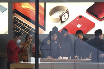 Customers at an Apple store in Beijing, where sales have slowed due to consumer anxiety over the trade war.