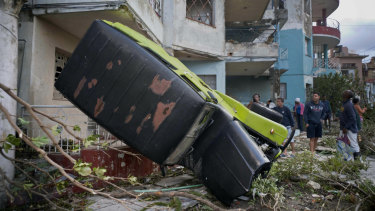 A truck is toppled against a home after a tornado in Havana, Cuba.