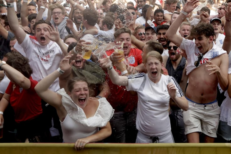 Oh yes: England soccer fans celebrate their second goal as they watch a live broadcast  in   London.