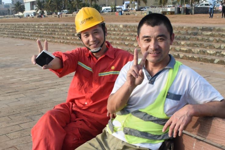 Chinese construction workers relax at the Galle Face Green, near the Port City Colombo reclamation site.