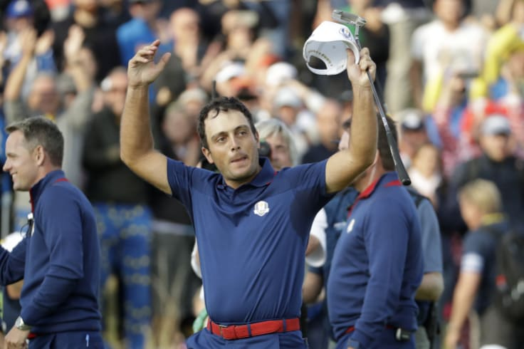 Riding high: Francesco Molinari celebrates a win in the Ryder Cup.