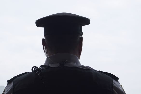 Why did a police officer give out a woman's address to her abusive ex?
