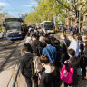 Commuters waiting for replacement buses along St Kilda Road, near the Shrine of Remembrance.