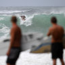 Wet weather halts but brings powerful surf in south-east Queensland