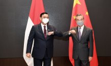 From left: Luhut Binsar Pandjaitan, the special envoy for Indonesia leader Joko Widodo, meets with Chinese Foreign Minister Wang Yi on Saturday.