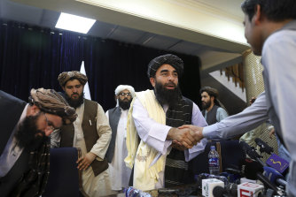 The Taliban have a polished communications team now. Their spokesman Zabihullah Mujahid shook hands with a journalist after his first news conference in Kabul on Tuesday night,