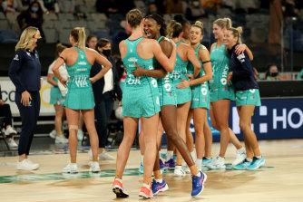 Mwai Kumwenda and Emily Mannix celebrate after Melbourne's win.