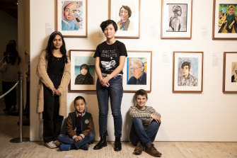 Winners of the Young Archie competition: Aysha Huq, 16; Matthew Chen, 8; Celeste Hang, 15; and Callum MacGown, 11, in front of their winning portraits at the Art Gallery of NSW.