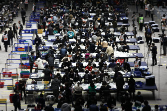 Officials in Seoul count votes cast in Parliamentary election amid the coronavirus outbreak.