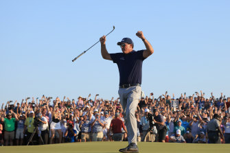 Phil Mickelson celebrates his record-breaking PGA Championship victory.