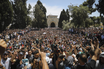 Worshippers protest against the likely evictions of Palestinian families from their homes in front of the al-Aqsa Mosque in Israeli-occupied East Jerusalem on Friday.
