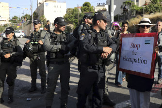 Israeli police stand guard at a demonstration in support of Palestinians in Sheikh Jarrah of East Jerusalem, where dozens of families face imminent forcible eviction from their homes by Israeli settlers.