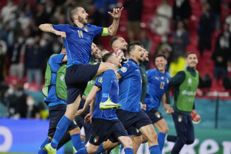 The Italians celebrate advancing to the quarter-finals.