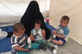 Shayma Assaad and her three sons in her tent at the al-Hawl camp.