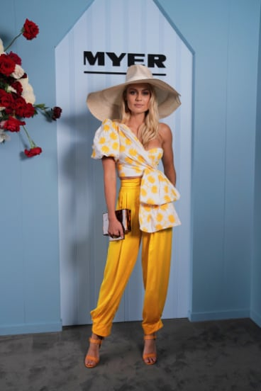 Myer Ambassador Elyse Knowles wearing Acler and Millinery by Melissa Jackson poses during the Lexus Melbourne Cup Day.