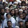 Thousands mourn the cleric known as the 'father of the Taliban'