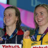 Australian gold medallist Ariarne Titmus, centre, stands with silver medallist United States' Katie Ledecky and her compatriot and bronze medallist Leah Smith after the 400m freestyle final.