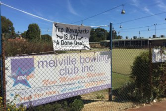 Banners voicing the Melville Bowling Club's opposition to the proposed wave park.