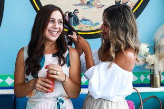 Katherine Saab gets her hair beachwaved by Ashley Schuberg.