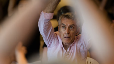 Craig Taylor participates in a dance class for people who have Parkinson's disease and their carers in the Utzon Room at the Sydney Opera House