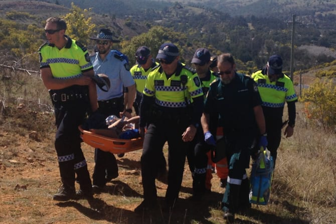 Emergency services help Kathleen Bautista to safety. She was found in a remote area of the Cotter near Canberra after seven days of being reported missing in 2015.