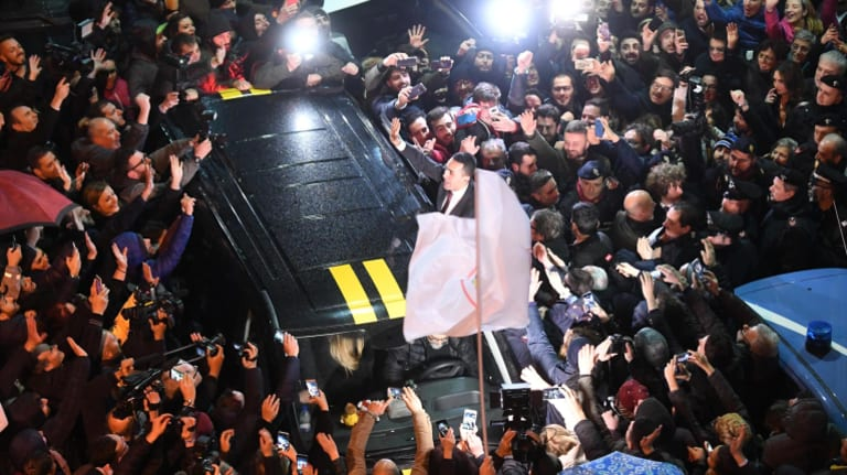 5-Star's leader and candidate for the post of Italian Prime Minister Luigi Di Maio arrives to celebrate their electoral victory in Acerra, near Naples, on Tuesday.