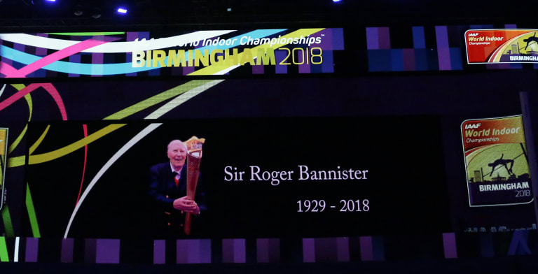 A video screen shows a tribute to Roger Bannister at the World Athletics Indoor Championships in Birmingham.