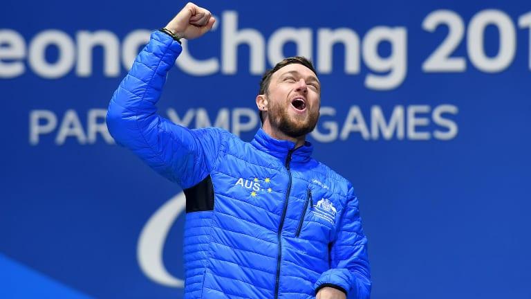 Simon Patmore celebrates his gold medal.