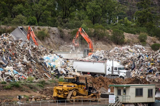 Hive of activity: At BMI Group's Swanbank recycling facility, the grey truck seen tipping on the left, which carries NSW plates, adds to a pile of unprocessed waste being loaded on to local trucks.