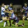 Waratahs back-rower Jack Dempsey is tackles by Reds backs Jordan Petaia and Bryce Hegarty.