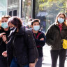 People are wearing masks shopping in Pitt Street.