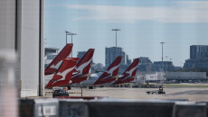 Queensland Health is urgently trying to trace passengers on a Melbourne to Brisbane Qantas flight on April 22.