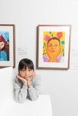 Nauen Lee, 9, winner of the 9-12 year-olds with her work 'My pretty mum'.