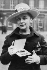 Caldwell after receiving an OBE at Buckingham Palace in London in 1970.