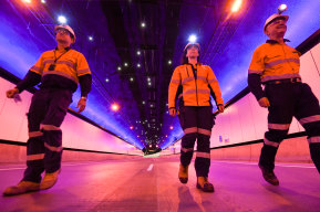 Mechanical and electrical manager Charles Giuttari (right) walks through the NorthConnex tunnel.