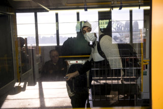 The NSW government is being urged to implement the use of face masks on public transport to reduce the spread of coronavirus.