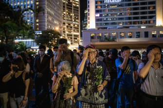Protesters cover their left eyes and stand in silence during the 74th Liberation Anniversary Assembly  on August 30, 2019 in Hong Kong.