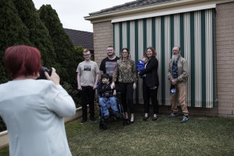 Farewells to family at Paige's home in Metford, near Maitland the morning of her enlistment.