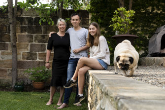 Kate Lorden with her teenage children Oliver and Liza Smith at home in Balmain.
