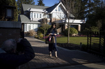 By contrast, in Vancouver, Meng Wanzhou, the chief financial officer of Huawei, stands in front of one of her two mansions, where she is under house arrest. She wears an electronic bracelet on her ankle and is free to travel around the city.