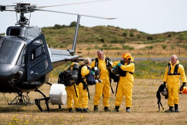 'We don't give up easily': Recovery team return to island in search of bodies
