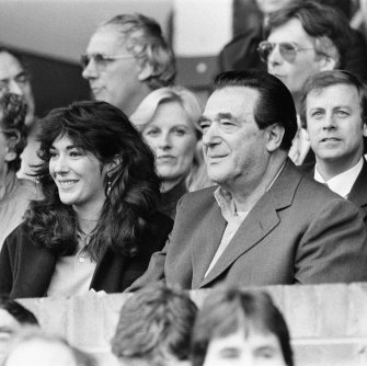 Robert Maxwell and his daughter Ghislaine watch a soccer match between Oxford United - which Robert Maxwell owned - and Brighton & Hove Albion  in 1984.